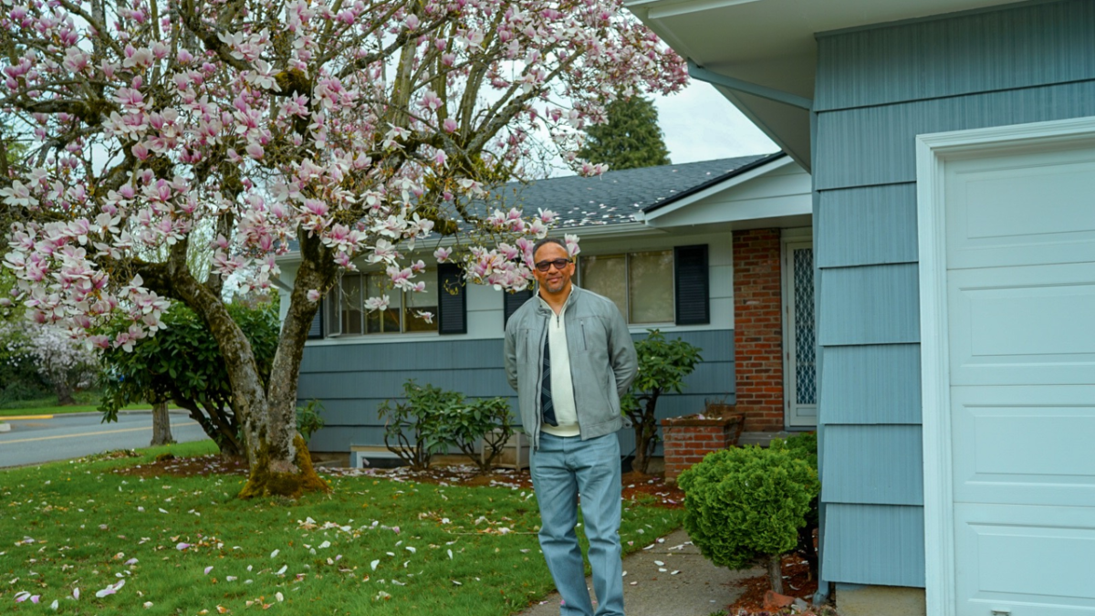 Man standing in front of a house