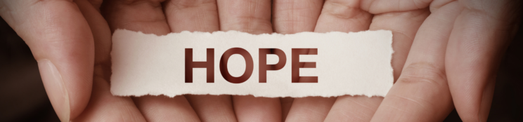 Hands holding the word Hope