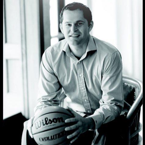 Luke, sitting holding a basketball
