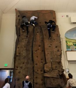 Young people climbing a rock wall